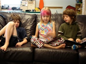 3 kids on couch